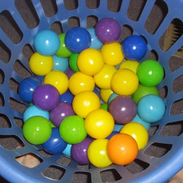 A basket of ball pit plastic balls