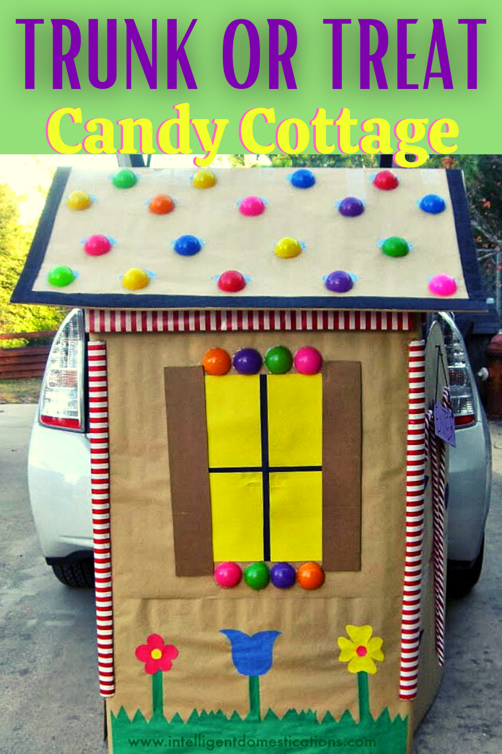An image of a  Halloween Trunk or Treat Design that looks like a candy cottage sitting behind a car for church trunk or treat even