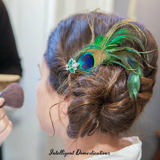 Peacock theme wedding ideas. Peacock hair piece. Photo of peacock feather hair piece for wedding