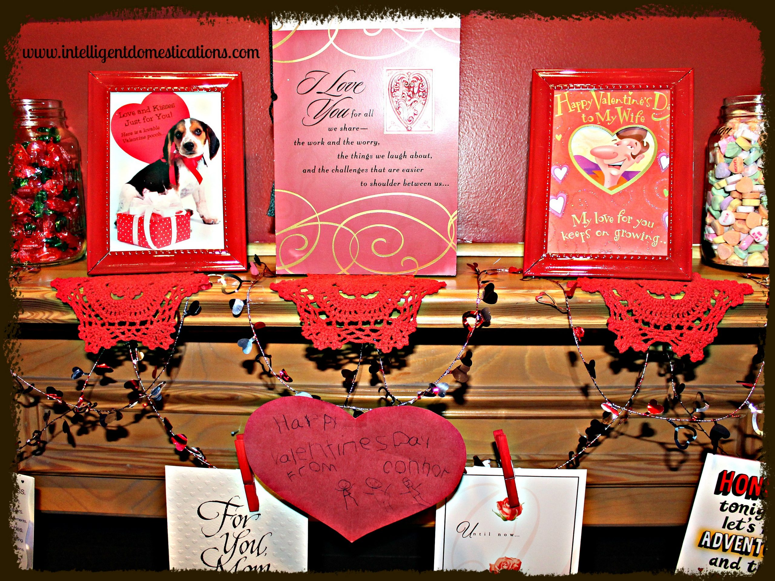 A Mantle decorated for Valentines by repurposing old Valentine cards for a walk down memory lane. Simple Valentines Mantle Decor Ideas