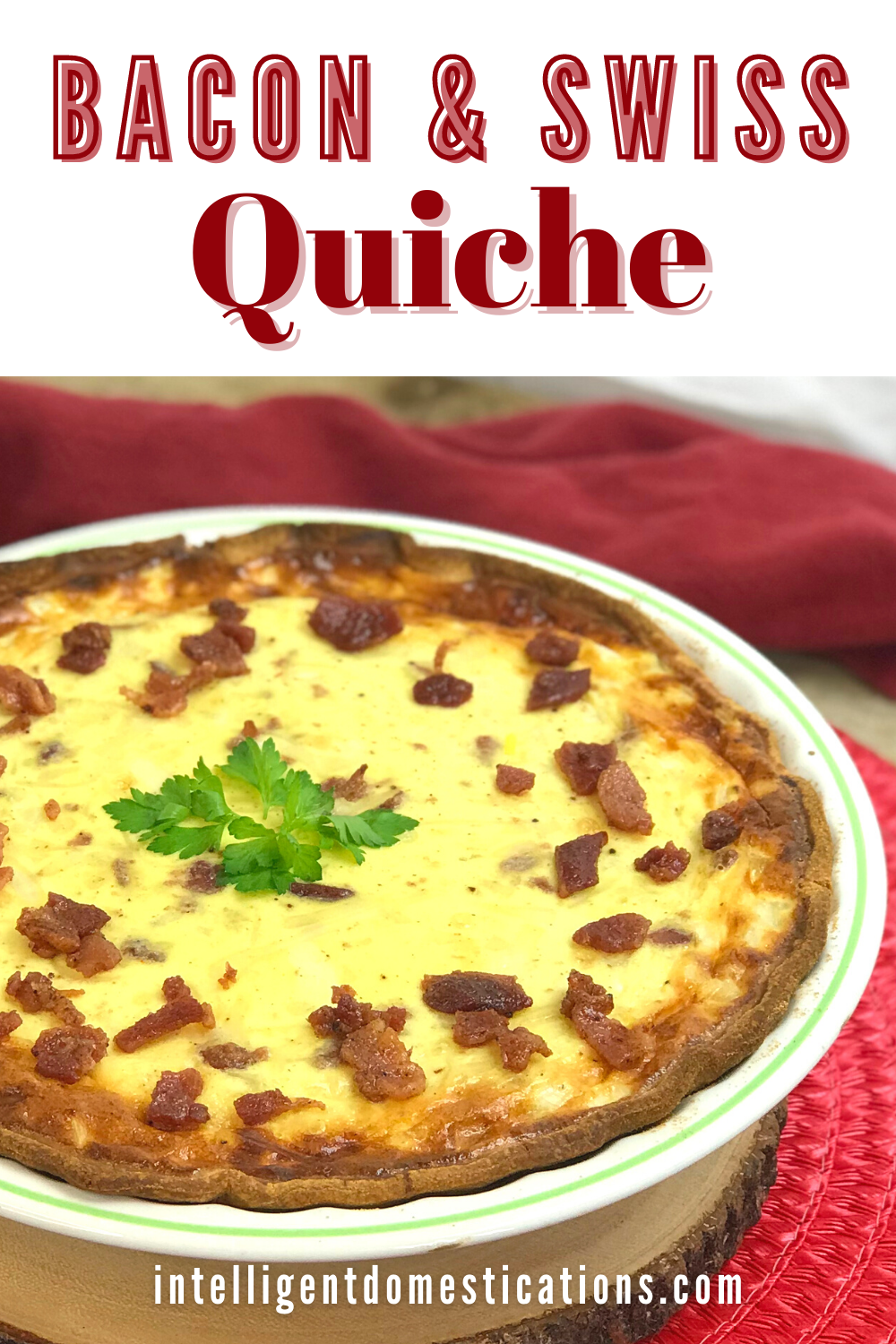 Quiche Lorraine in a pie plate on a table with a red cloth in the background