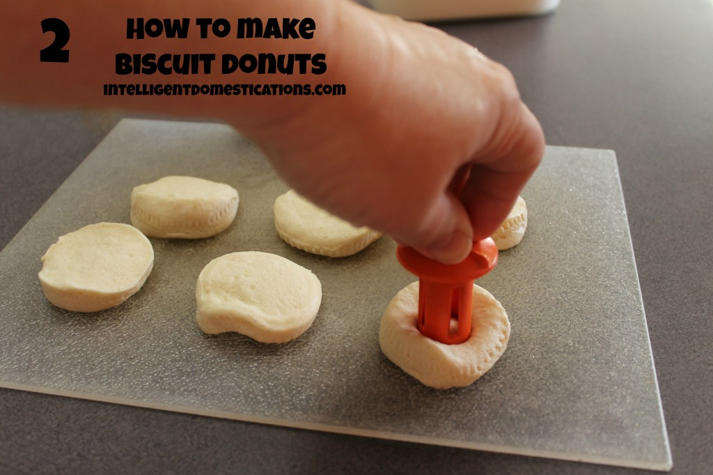 Cutting the Donut holes for Biscuit Donuts. How to make Biscuit Doughnuts. Quick and easy dessert. Cheap dessert. #biscuitdonuts #dessert #kitchenhack