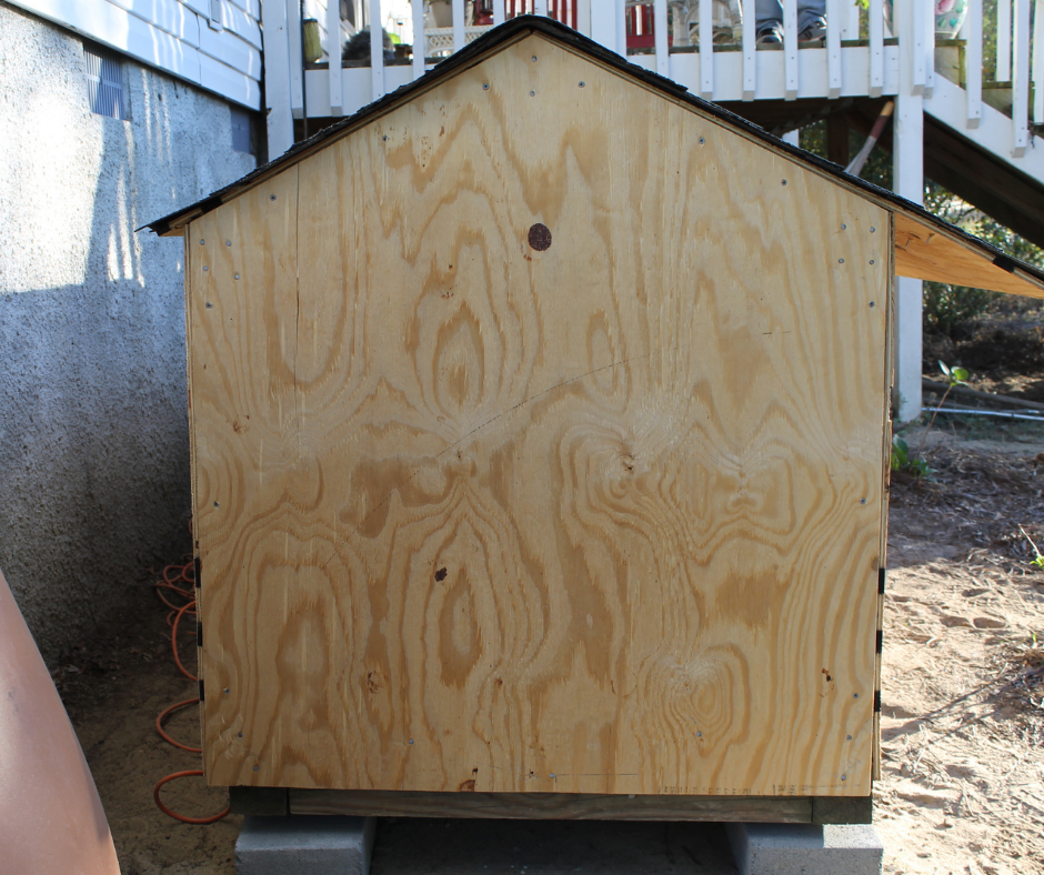 A DIY Wood Dog House in the process of being built