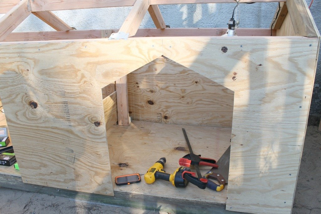 A Double Door dog house being built