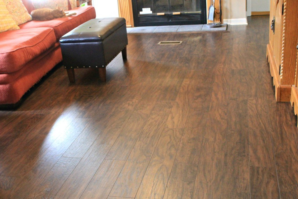 AFTER picture of Pergo Laminate flooring in the den