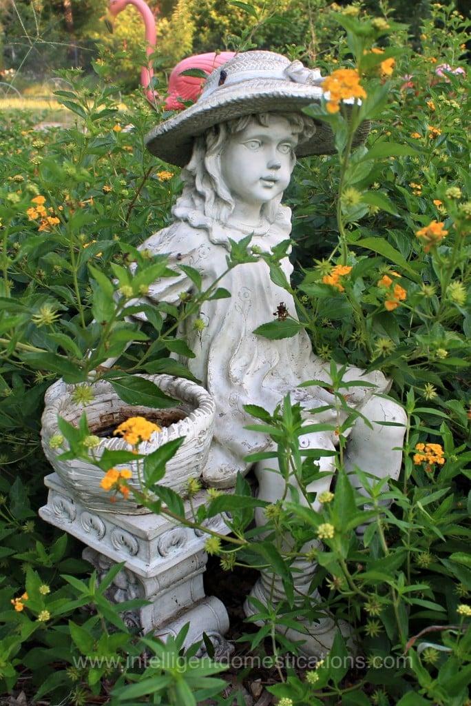Momma's Flower basket girl sits amongst the lantana.www.intelligentdomestications.com