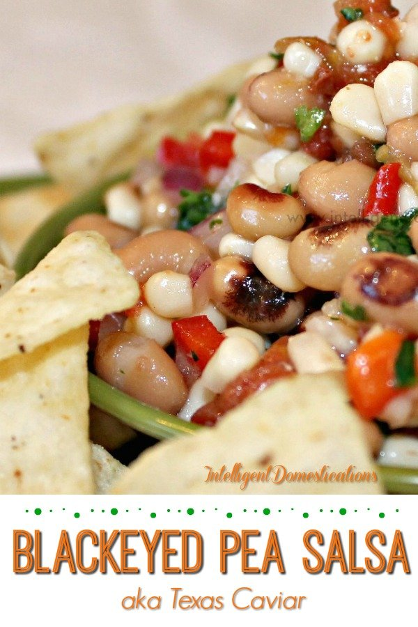 A bowl full of Blackeye Pea Salsa aka Texas Caviar served with tortilla chips.