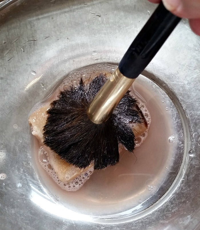Clean your makeup brushes with organic soap.Gently swirl the brush around on the soap.intelligentdomestications.com
