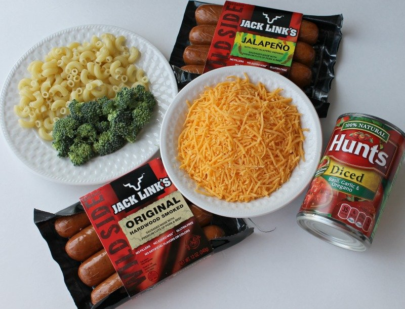 Make this one pot meal for a weeknight dinner or use it as a potluck recipe. This Crockpot Casserole uses only seven ingredients and there is macaroni and cheese involved. Broccoli, Sausage, Macaroni and Cheese combine for a flavor packed meal. #Crockpotrecipe #casserole #potluck