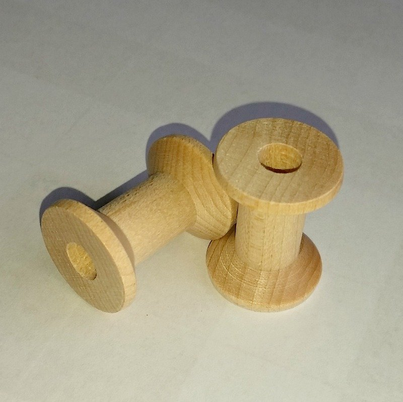 Wooden spools for drawer pulls