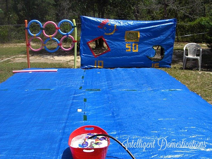 Outdoor Water Games for family fun. All you need is tarps, colored Duck tape, Pool noodles, water balloons and water