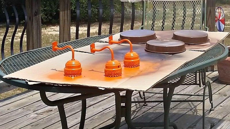Spray painting the lamp arms orange