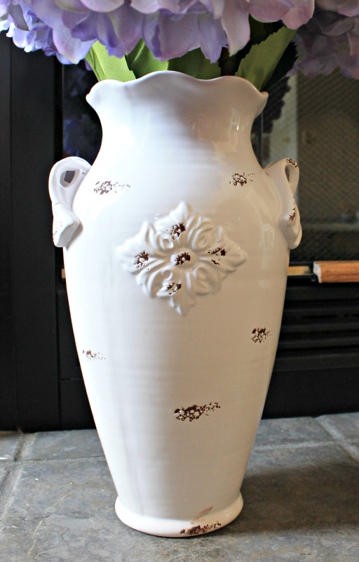 White chippy porcelain vase from the At Home store is the perfect piece for a bunch of giant purple hydrangea