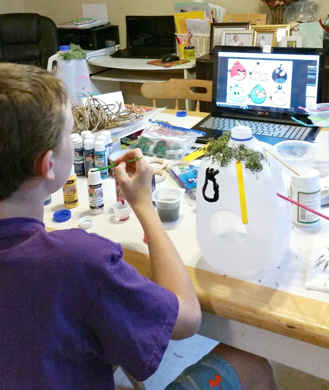 crafting-bird-houses-from-milk-jugs-painting-angry-birds-onto-the-side-of-the-bird-house