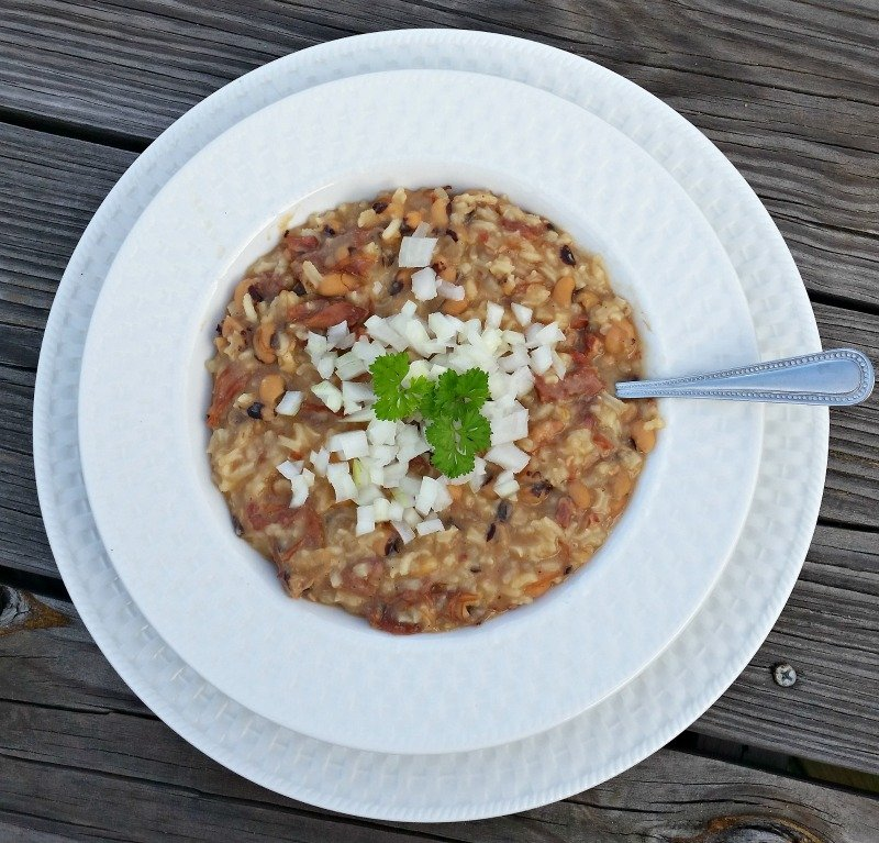 Easy recipe for Hoppin John which is a southern favorite winter meal. Black eye peas and rice cooked into a soup. Topping it with raw cut onions is optional. New Year's Day must have dish. #easyrecipe #soup #hoppinjohn