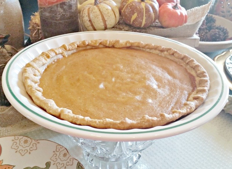 Easy recipe for Classic Pumpkin Pie a must have Thanksgiving dessert or Fall treat. We decorated ours with candy corn and whipped cream.