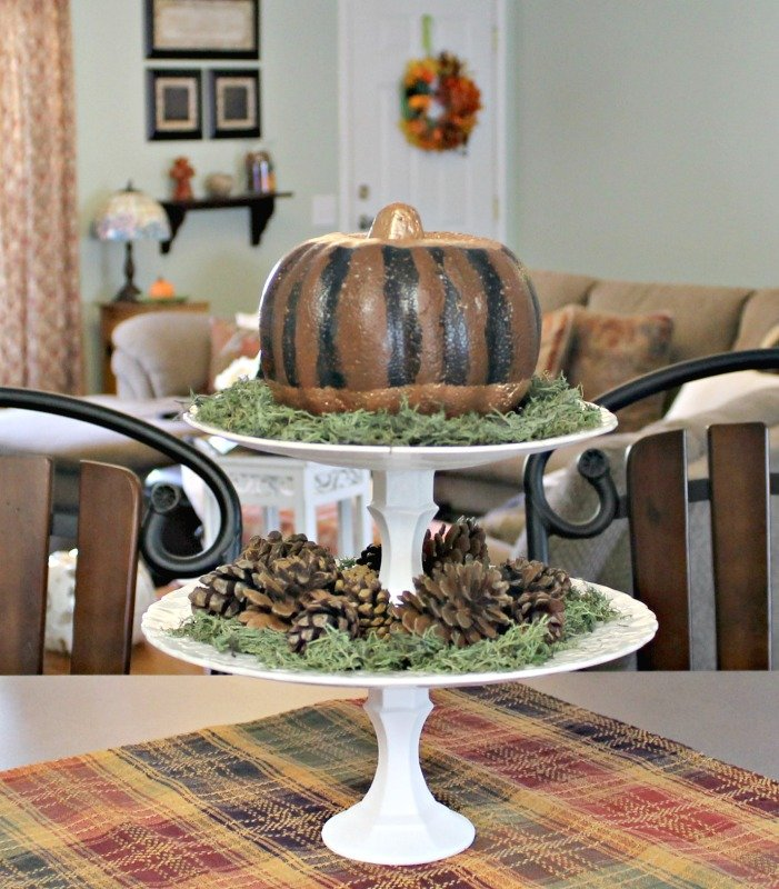 two-tired-pumpkin-stand-styled-with-pumpkin-and-pine-cones-for-our-fall-home-tour