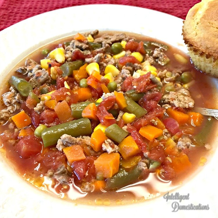 Easy Homemade Vegetable Soup recipe with only 6 ingredients. Can be made in the Slow Cooker or on the stove top. #soup #onepotmeal