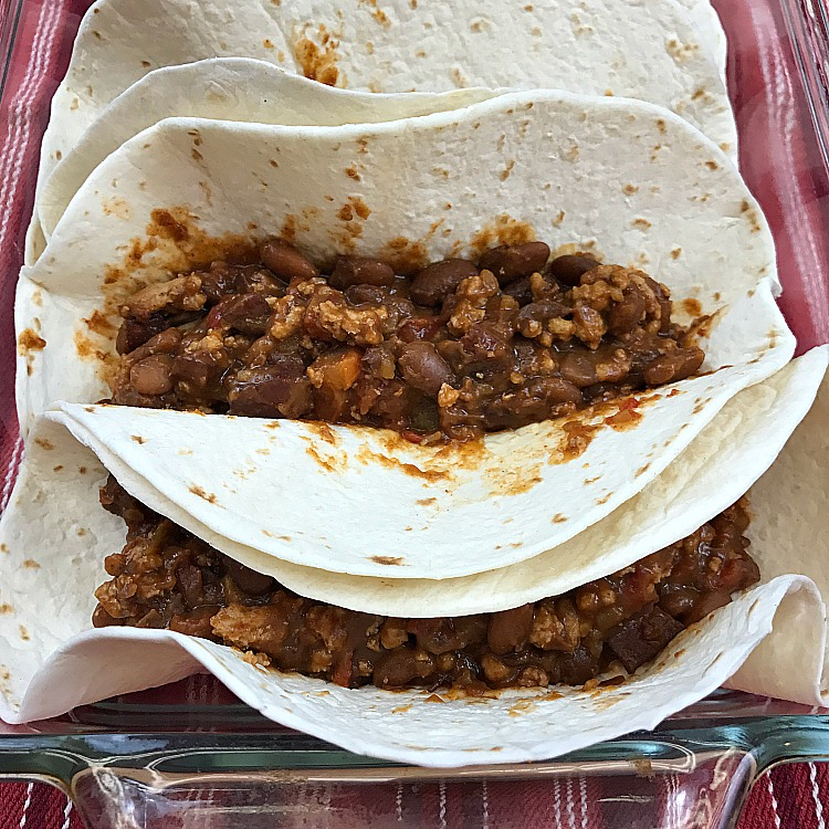 Easy Beef & Bean Burritos made from scratch recipe. Sometimes we want Burritos on Taco Tuesday! Beef and Bean Burritos make a cheap and easy weeknight meal. #burritos #mexicanrecipe #tacotuesday