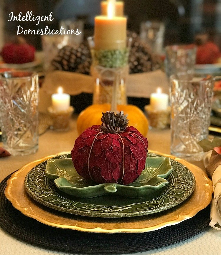 Thanksgiving Tablescape using Gold and Green, Pinecones, Pumpkins, Glass and Natural elements.