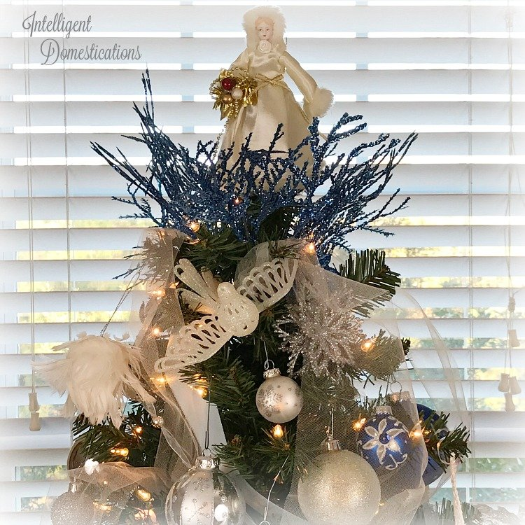 Blue and White Christmas Tree Decor. Royal Blue, White and Silver Christmas Tree Decorations. Trimmed with three garlands and white lights.