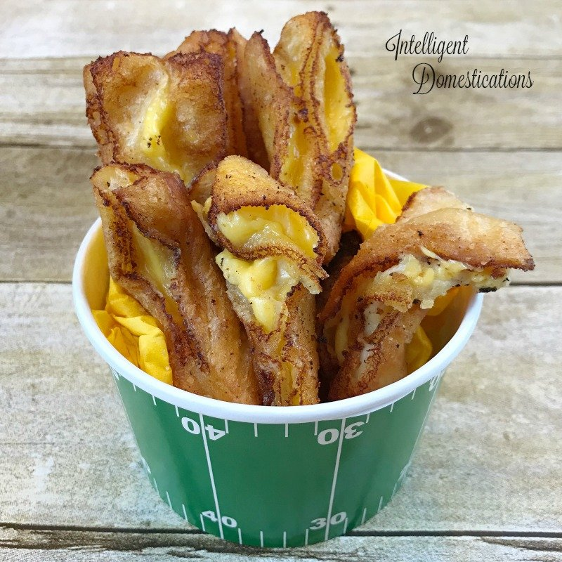 How to make Grilled Cheese fries using Crescent Rolls and process cheese like Velveeta. The deep fried Grilled Cheese fries are a delicious appetizer for Game Day or any party. #partyfood #appetizer #friedcheese