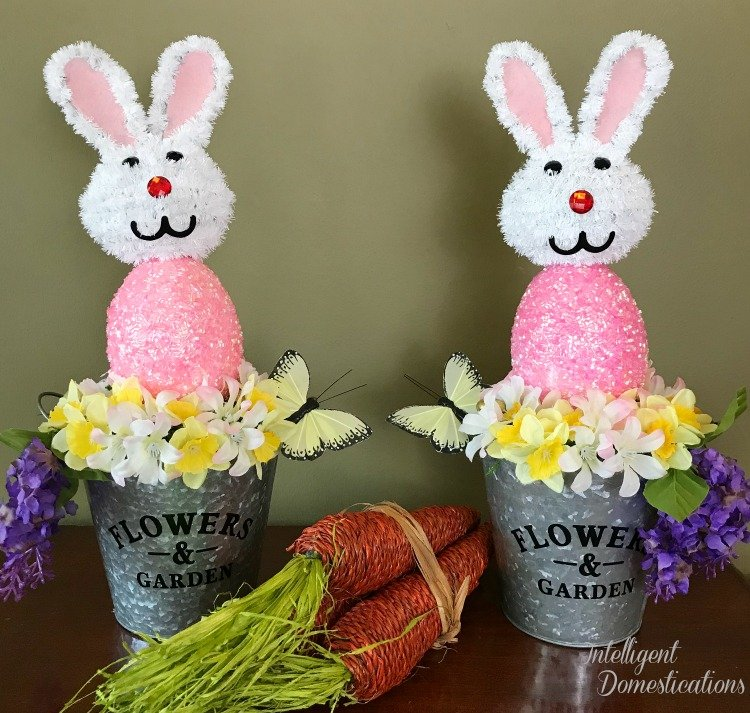 How to make an Easter Bunny Flower Pail for table or mantle decor. Dollar Tree Easter Craft. Galvanized Easter Centerpiece craft. Picture of galvanized Easter Bunny centerpiece
