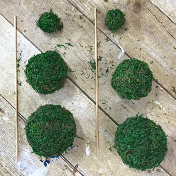 Cover your foam balls with moss using hot glue. How to make a mini moss ball topiary using Dollar store supplies. Blue and White Moss Ball Topiary DIY project. Make your own blue and white decor vignette pieces. #mossballs #minitopiary #diytopiary #diydecor #dollarstorecraft