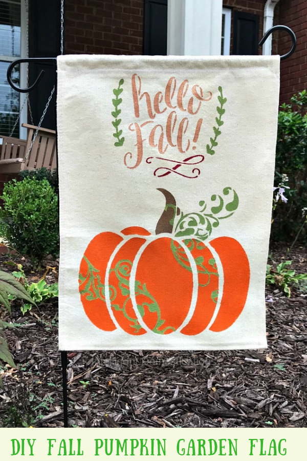 DIY Fall Garden Flag. This Tutorial includes how to make a garden flag using a drop cloth, stencils and paint. Quick and Easy DIY Fall Outdoor Decor project. #gardenflag #dropcloth #diy #falldecor #pumpkins #hellofall #fall #yardflag #autumn
