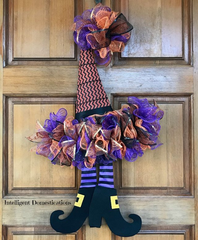 How To DIY A Witches Hat Wreath for Halloween decor. This Halloween wreath is made using Deco Mesh and a witches hat wreath form from the dollar store. This Witch wreath is a dollar store decor project. #halloween #witchhatwreath #halloweenwreath #diy #diywreath