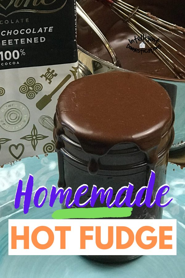close up picture of hot fudge sauce dripping down the sides of a Mason jar sitting in front of a chocolate baking bar and a small pot with more Hot Fudge Sauce in it