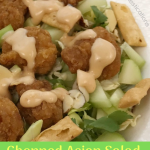 Asian Salad in a bowl with dressing being poured over it