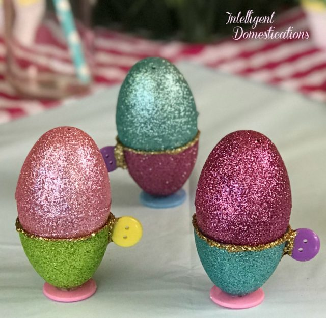 Make these Easy Egg Cups from Plastic Easter Eggs for the Kid's Easter Table or for pretend tea party decor. You only need three simple supplies and some glue. How to make these Easy DIY Easter Kids Table Decorations. #easter #diy