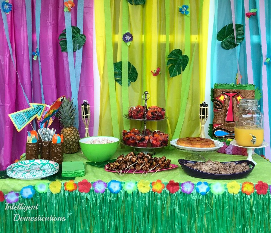 Luau party buffet table with lots of food