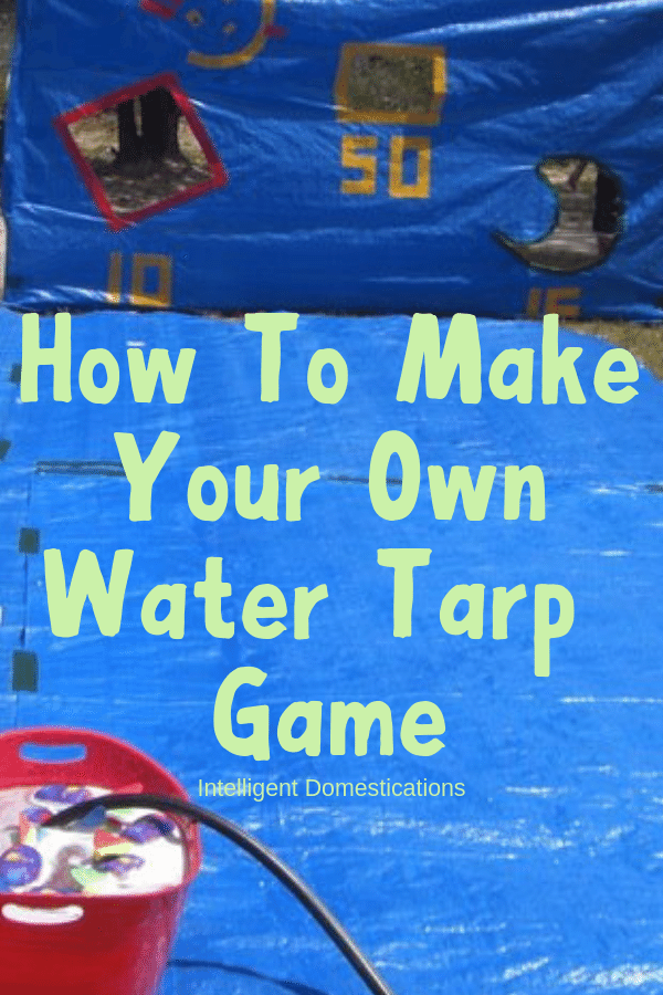 This one DIY Water Tarp Game will keep the kids busy with backyard summer water activities for hours! It's versatile for playing in the water. Play Water Balloon games, Water Bomb Target competitions. Pool Noodle Sword Fighting and a Slip and Slide surface and even use the Target Backdrop as a Photo spot! #watergames #summergames #outdoorplay