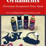 Wood cut out Christmas tree ornaments displayed on a table with craft paint