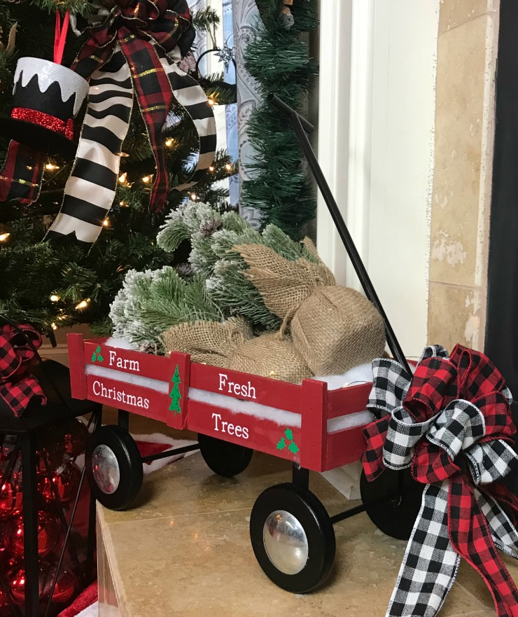 Little Red Wagon Christmas Decor carrying Farm Fresh Chrstismas Trees with a pretty buffalo check bow on the front.