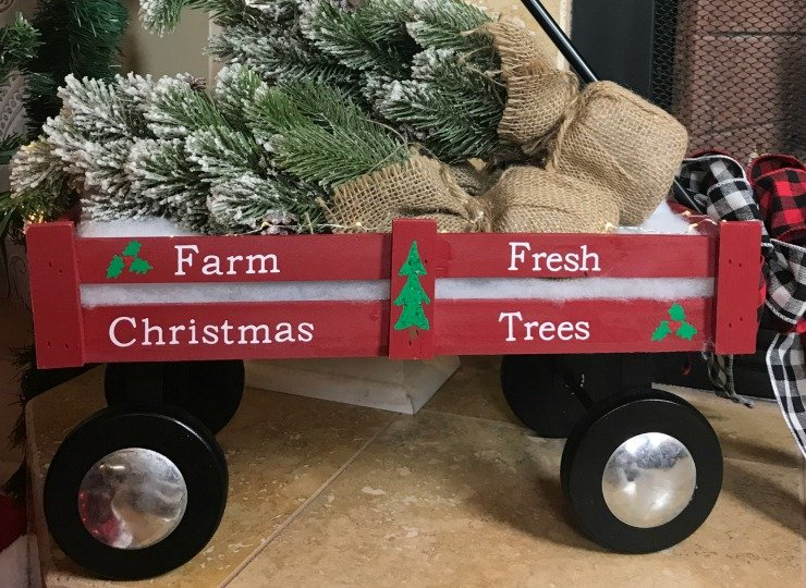 Paint the Christmas Tree and Holly onto the side of the Little Red Wagon.