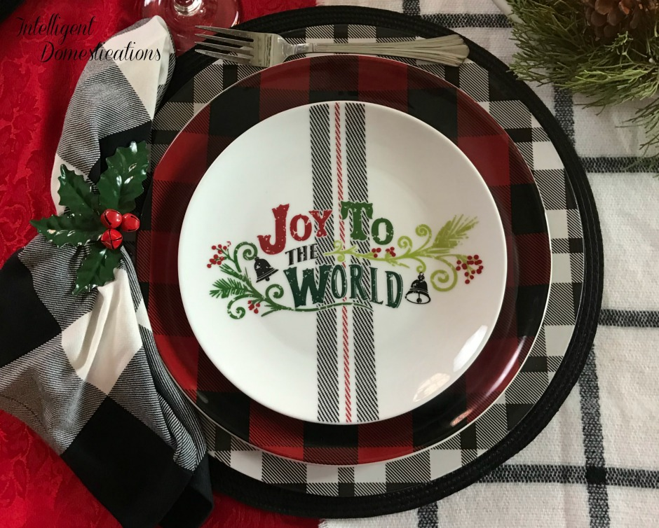 Red and Black plaid Christmas Tablescape. I paired a mix of buffalo plaid dishes with white and black plaid chargers and a few other pieces to create this Festive Plaid Christmas Tablescape
