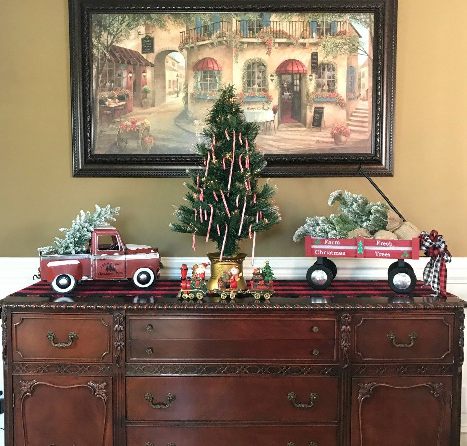 Dining room Sideboard decorated for Christmas to match the Plaid Christmas Tablescape. The Candy Tree is a nod to my GrandDad who used to make one for us when we were children