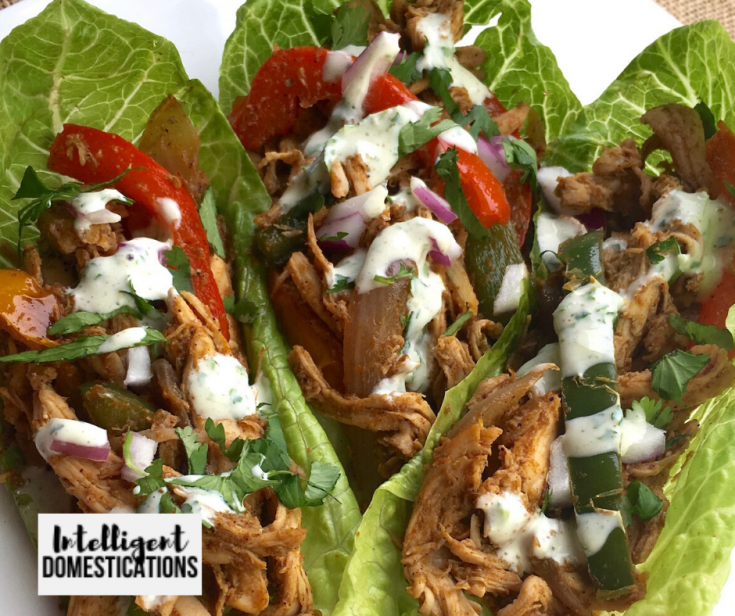 Easy recipe for Rotisserie Chicken Fajita wraps with homemade seasoning and made from scratch Cilantro Lime Sauce. Serve these as lettuce wraps or soft shell tortilla wraps. We have included a list of ways to serve your Chicken Fajitas and side dish suggestions. #chickenrecipe #Intellid Made from scratch Rotisserie Chicken Fajitas served in lettuce wraps
