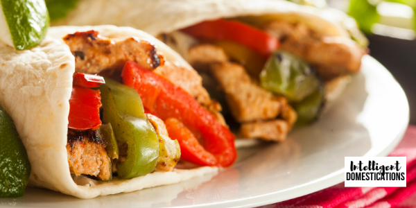 Homemade Rotisserie Chicken Fajitas weeknight meal idea. Drizzle with homemade Cilantro-Lime Sauce, recipe included.