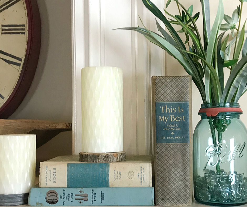 Tips for Decorating a Spring Mantle with plants, candles, old books and greenery. I used what I had on hand to create a simple Spring Mantlescape