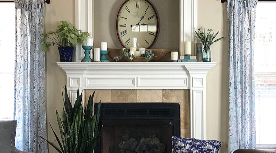 Simple Spring Mantle Decor Ideas inspired by a Pinterest search. Candles, Books and greenery create a simple Spring mantle
