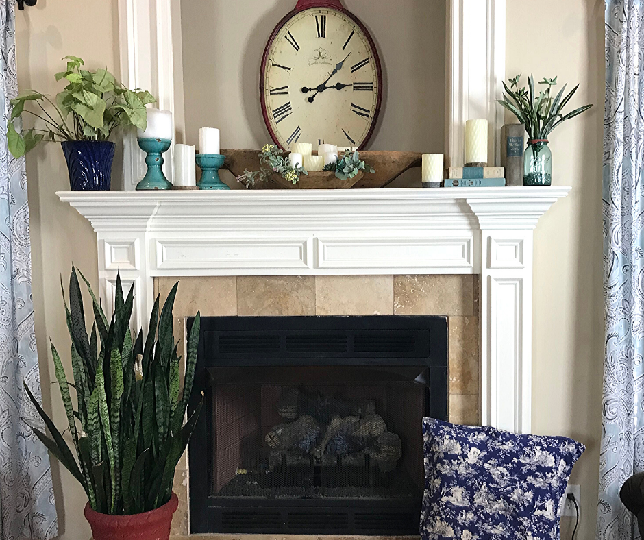 Spring mantle decor using cheap and easy ideas. Decor for the season using items you already have around the house like books, candles and greenery.