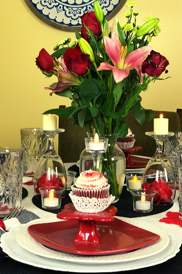 Valentine's Table decor. Red White and Black solid colors with black and white buffalo plaid napkins. Roses and mixed floral bouquet centerpiece