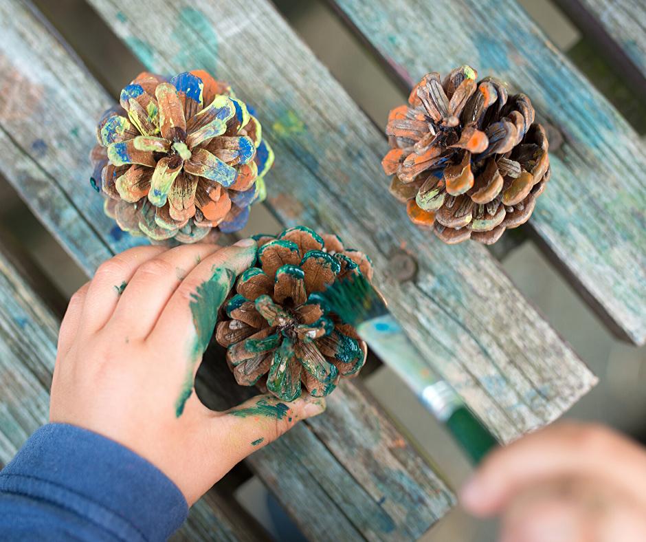 Children painting pine cones