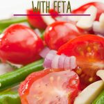 Make a summer salad with fresh from the vine green beans and grape tomatoes. Toss in some fresh herbs and dressing then add a bite of salty with Feta Cheese. Get the easy recipe to entertain your summer BBQ guest or serve at your Thanksgiving dinner. #greenbeansalad #greenbeans #saladrecipe #intellid
