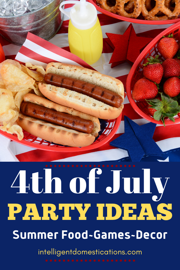 Hotdogs and summer food on a red white and blue decorated table for 4th of July