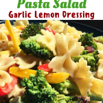 Pictures of Bowtie Pasta with broccoli and yellow and orange bell peppers served on a dark plate
